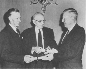 Ted Still and C. I. Fitch receiving certificates from President Cecil Frutchey signifying their selection for Honorary Life Membership in The Potato Association of America at the annual meeting December 6, 1956. Prof. James G. Milward & Kris P. Bemis who were also honored could not attend.
