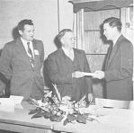 Dr. Reiner Bonde (center) accepting Honorary Life Membership Certificate from President Hougas at Annual Banquet of the Potato Association of America, Dec. 2, 1957. Paul Mosher (left) sponsored Dr. Bonde.